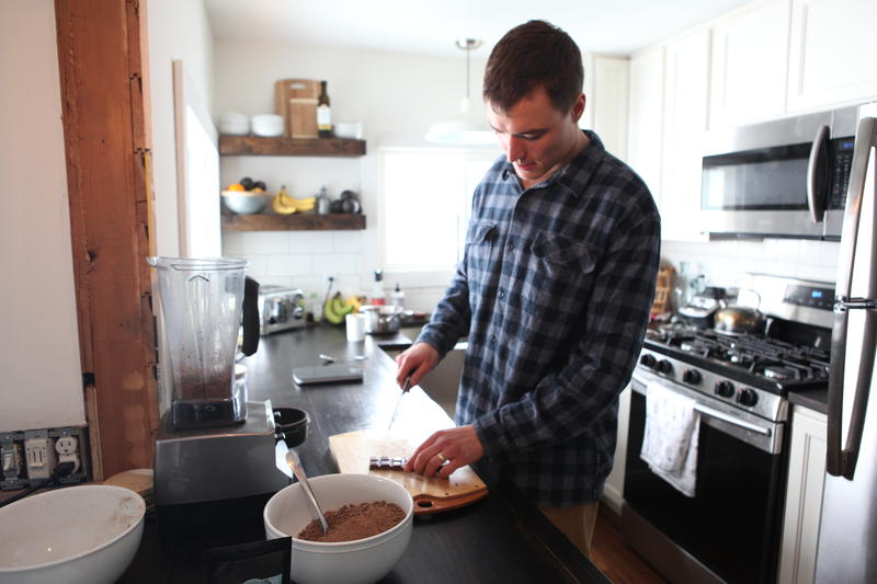 Matt Shepler prepares to blend some Ambrosia Sipping Chocolate in his kitchen in Traverse City.