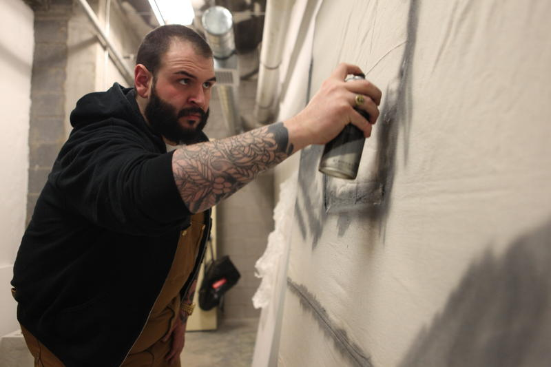 Spencer McQueen paints in his studio in downtown Traverse City.