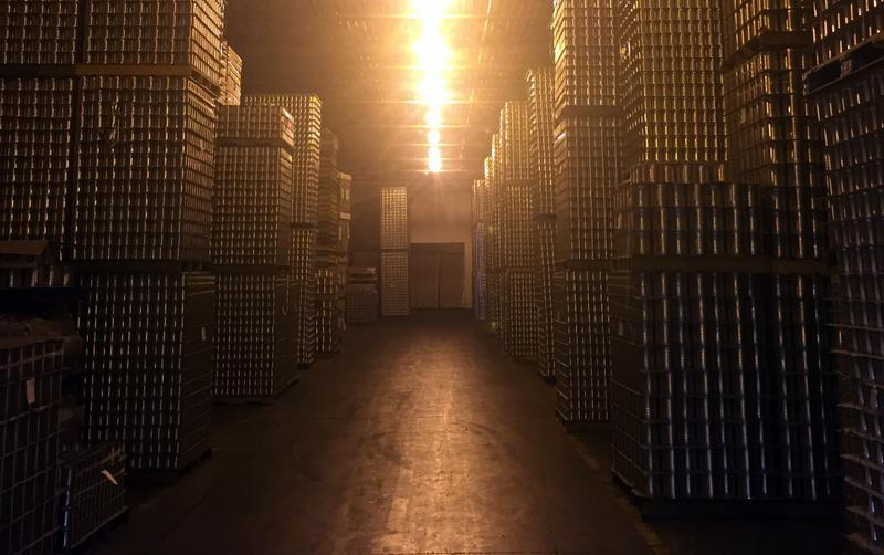A warehouse at Burnette Foods in Elk Rapids filled with cans of cherry pie filling.