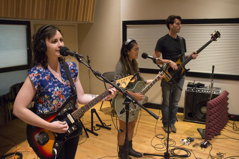 Kate Pillsbury (left), Emilee Petersmark (center) and Ben Zito (right) of The Crane Wives perform in IPR's Studio A.
