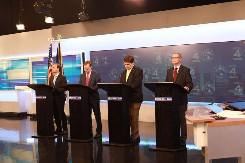 From left to right: Lt. Gov. Brian Calley, Attorney General Bill Schuette, State Sen. Patrick Colbeck and Dr. Jim Hines before a televised debate last week.