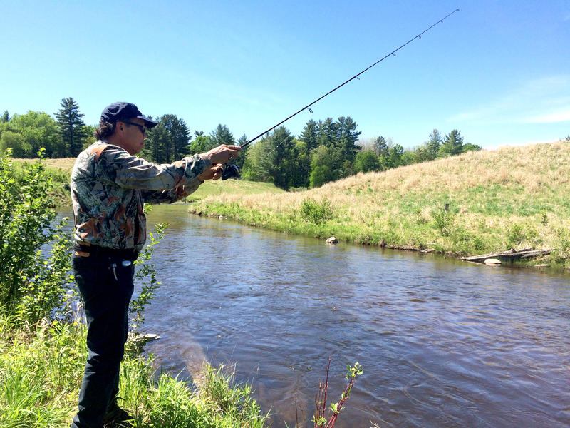 Hank Bailey casts a line into the Boardman River.