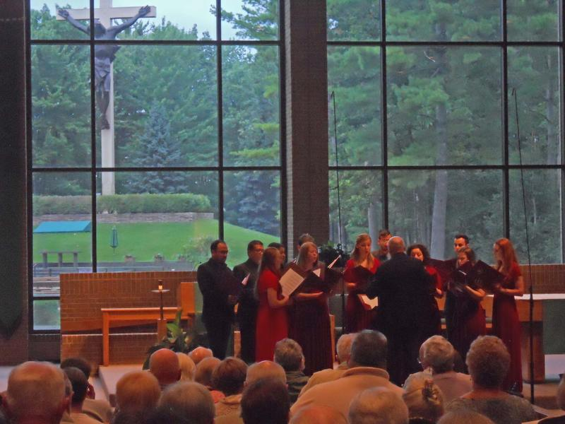 The Pontifical Institute of Sacred Music's Gregorian Schola performs at the Cross in the Woods Shrine in Indian River earlier this week.