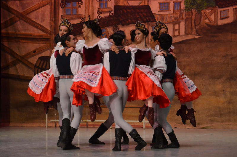 Happy villagers dance in a production of this week's ballet, COPPELIA, by Leo Delibes. Interlochen Public Radio - classical music for kids!