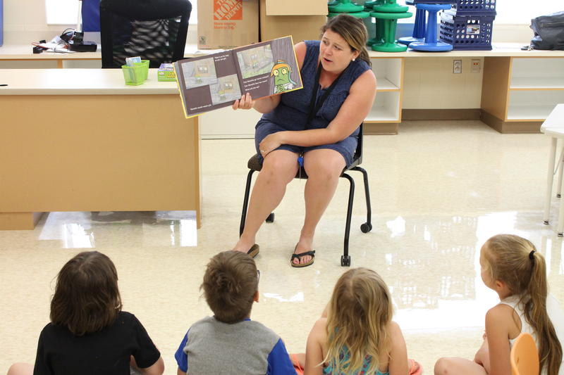 Students listen attentively during a summer reading course at Blair Elementary School.