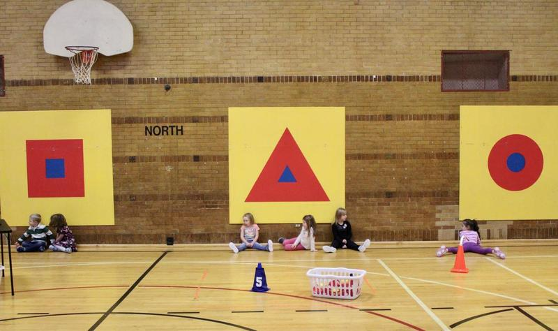 Kindergarteners rest at the end of gym class at Central Grade School in TCAPS.