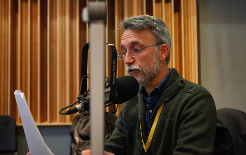 Bill Church, theatre director at Interlochen Art Academy, performs a section of 'A Christmas Carol' at Interlochen Public Radio.