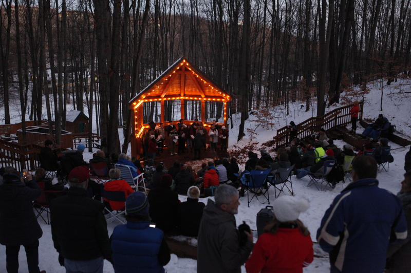 Nearly 100 people gather to hear the Benzie Central Chamber Choir perform at Michigan Legacy Art Park in Thompsonville on Saturday.