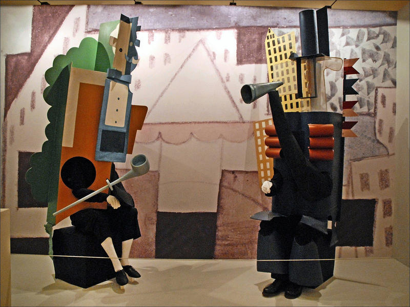 KC 257 - Parade: Pablo Picasso designed strange, cubist costumes for the dancers in Satie's controversial ballet. Those look pretty awkward for dancing!