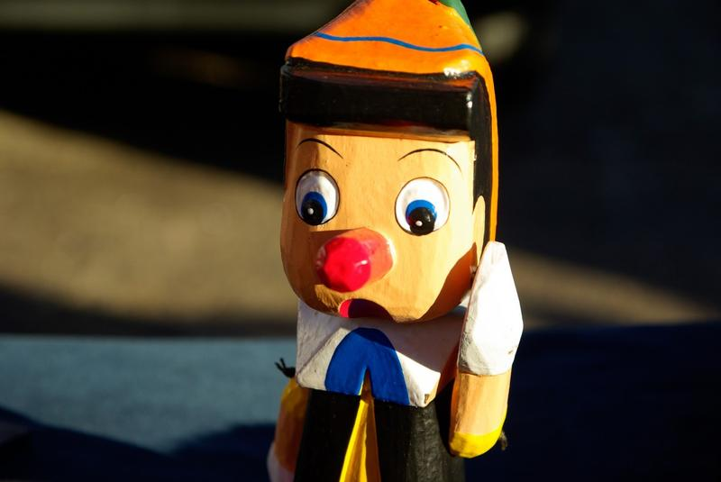 A wooden Pinocchio puppet.