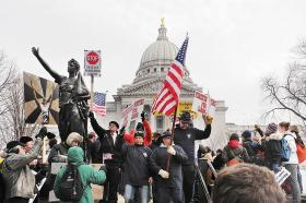 (Feb, 2011) Protesters of Act 10 are joined by Wisconsin firefighters, unaffected by the legislation.