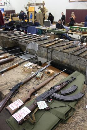 Gun dealer Larry Marshall's tables of hunting rifles, vintage military guns, shotguns and a lone AK-47 greet a larger than expected crowd at the Menomonie Sportsman's Expo and Gun Show.