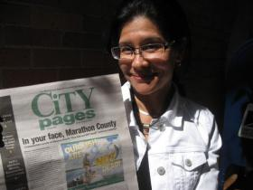 City Pages publisher Tammy Stezenski poses with the April Fool's Day edition of the newspaper.