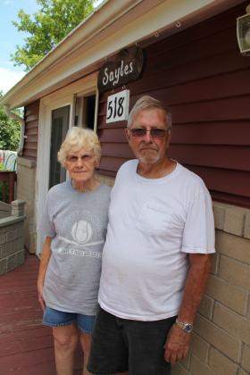 New Auburn residents Frances and Dean Sayles say the influx in frac sand facilities has changed the community. They are worried about their health.