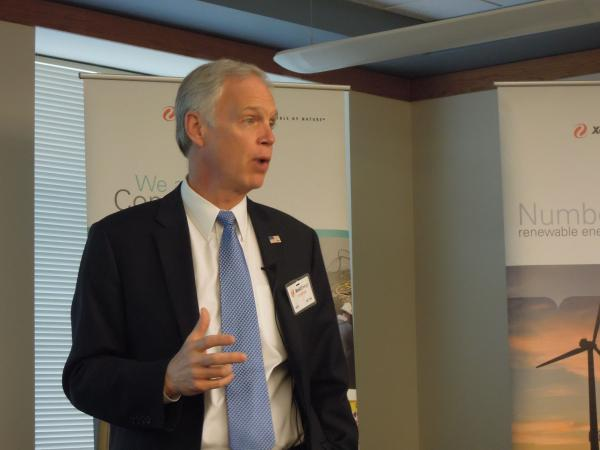 US Senator Ron Johnson speaks to workers at Xcel Energy's headquarters in Eau Claire.