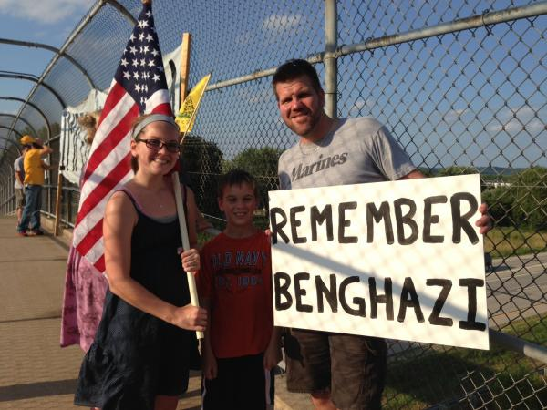 protesters on an overpass, calling for impeachment and remembering Benghazi