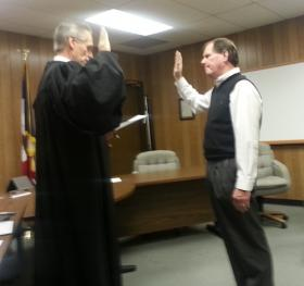 Judge Michael Schilling (L) administers the Oath of Office to new Supervisor Matt Pflug.