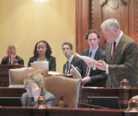 Senator Bill Haine (D-Alton), standing at right, debates medical marijuana in the Illinois Senate on Friday.