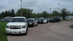 Police cars at Macomb Jr. Sr. High School during lockdown 5-9-13