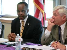 WIU President Jack Thomas and Trustee William Epperly during the meeting in Moline