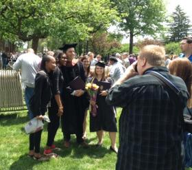 Ed Helms takes photo with graduates