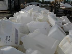 The program recycles the jugs into fence posts and shipping pallets.
