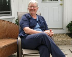 Becky Doyle sits on the patio outside the hog and grain farm she and her husband run in central Illinois.