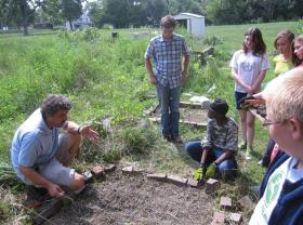 Student at Knox College's urban farm, council now approved farming in the rest of Galesburg.