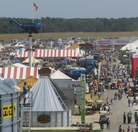 Visitors stroll through exhibits at the Farm Progress Show.