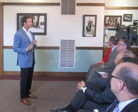 Schock at a listening session at Macomb City Hall.