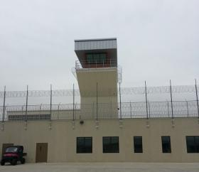 This guard tower has a visual on the entrances to multiple buildings.