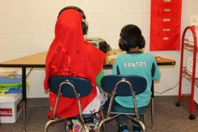 "Two students in a ""newcomer"" class at Florence Wilson Elementary School in Garden City: a Somali girl (left), and a Latino boy."