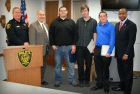 (From left) Deputy Chief Eric Lenardt, Mayor Mike Inman, Owen Hill, Ryan Brushaber, Matthew Demetral, and WIU President Jack Thomas