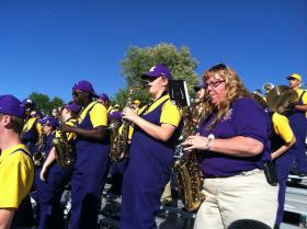 Deb Cassidy-Roscamp (right) plays with the WIU Marching Leathernecks during Homecoming.
