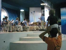Local residents take in a concert of the WIU Wind Ensemble during the group's 2010 tour of Brazil.