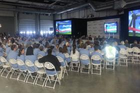 Siemens employees listen to the big announcement about a project with Mid-American Energy.