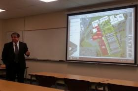 SCC President Michael Ash presents a conceptual drawing in Keokuk.  The red areas are proposed new buildings.