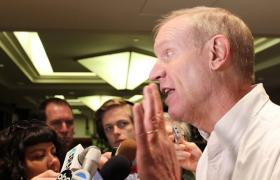 Bruce Rauner speaks with reporters late last summer