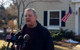 U.S. Sen. Dick Durbin speaks with reporters Sunday outside his home in Springfield.