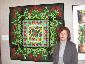Pat Hobbs with her latest quilt. She said it takes six months to complete a quilt.
