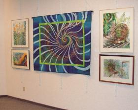 This quilt and these water color paintings remain on display through March 8 at the West Central Illinois Arts Center
