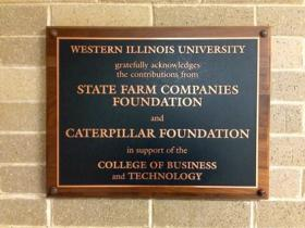 Thursday's announcement was made in a lecture hall also paid for partially by State Farm Insurance.