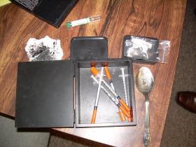 Heroin and paraphernalia seized during an earlier raid