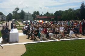 Several hundred people listen to Governor Terry Branstad talk about the need to loan Keokuk Area Hospital $5-million.