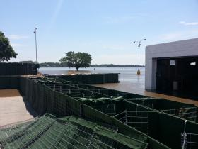 Large barriers are being placed around Memorial Auditorium in Burlington to hold back the Mississippi River.