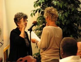 Millie Gilbert (left) was sworn into office by City Clerk Melanie Falk. Alderman At Large Don Wynn looks on.