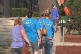 Members of the GEA head into Thursday night's meeting. They voted to walk off the job if no contract agreement is reached by August 12.