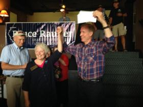 McDonough County Republicans' Chairwoman Mary Brookhart presents Bruce Rauner with a $10,000 check.