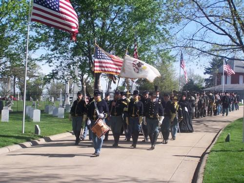 Soldiers entering the Keokuk National Cemetery for the ceremony to spread native soil on the graves of those who died during the Civil War