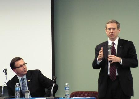 Senator Mark Kirk (standing) during an appearance in Macomb last year with Congressman Bobby Schilling